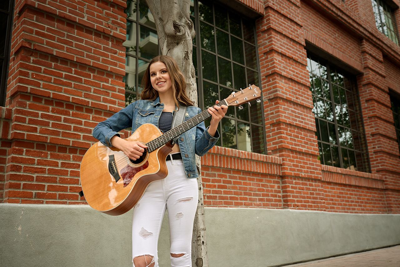 Bella Kaye playing guitar